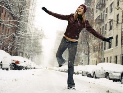 A girl jumping in the snow